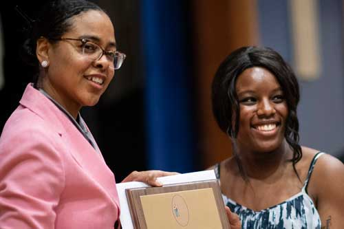 Kendall Moore presents Black Scholar Award to Chelsea Opong Wadeer