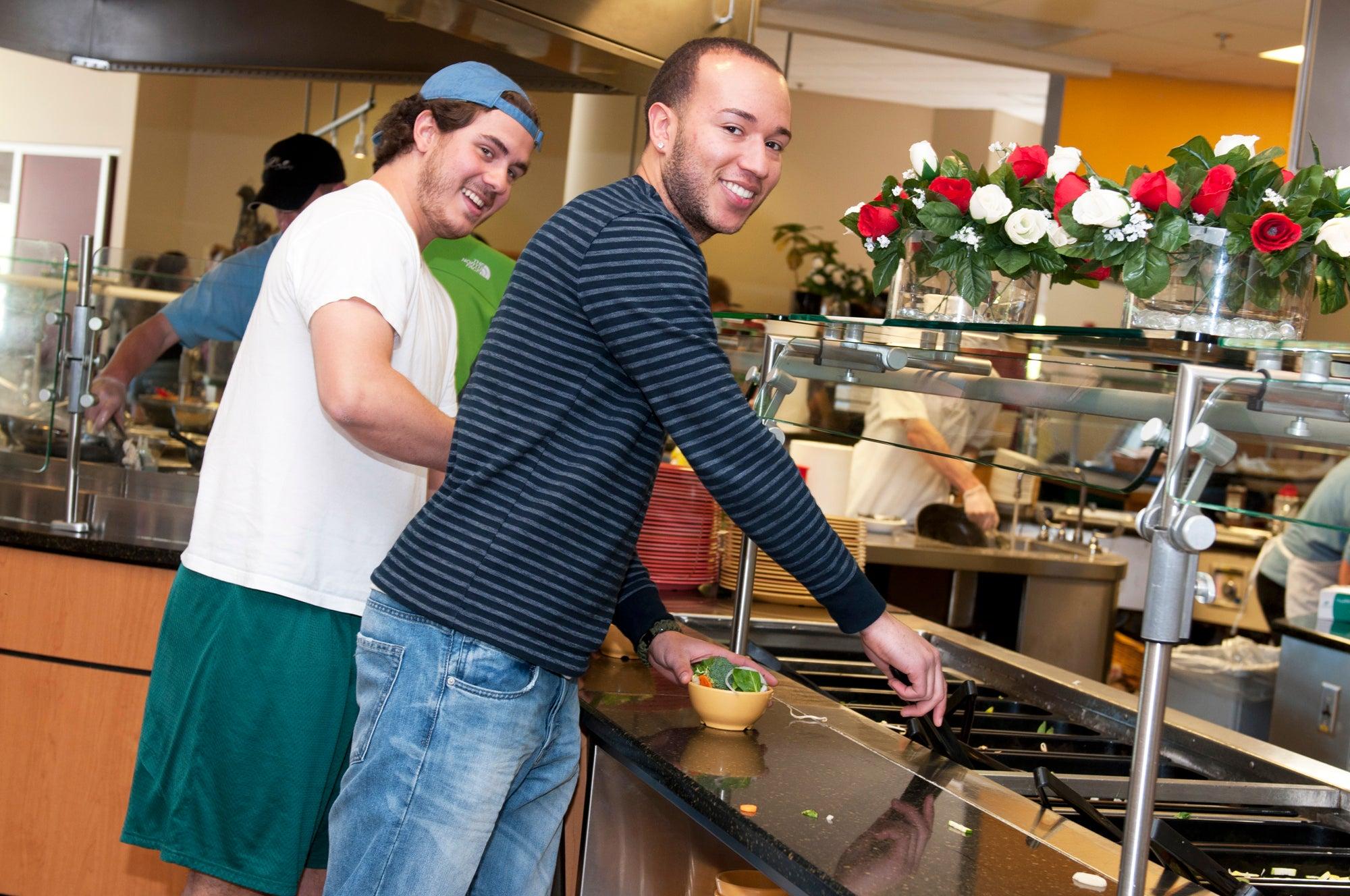 two students at salad bar