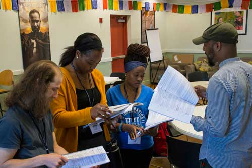 Participants work together in URI nonviolence summer institute