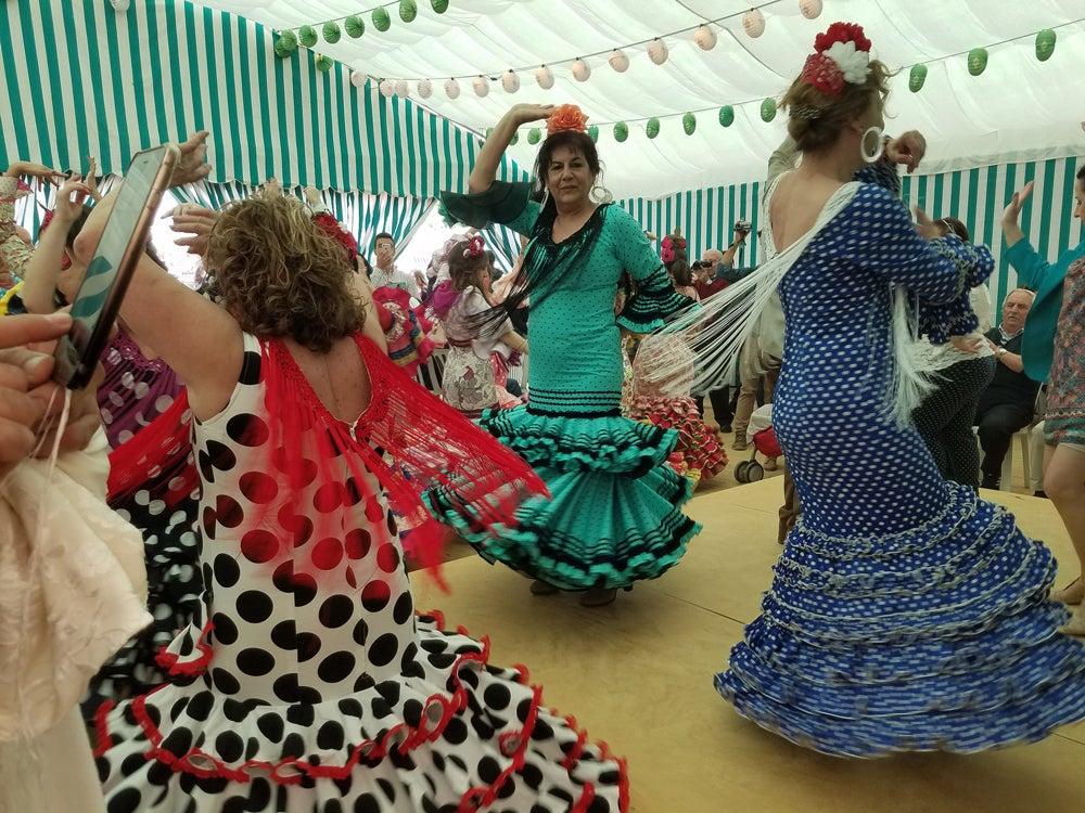 Women dancing in Seville, Spain