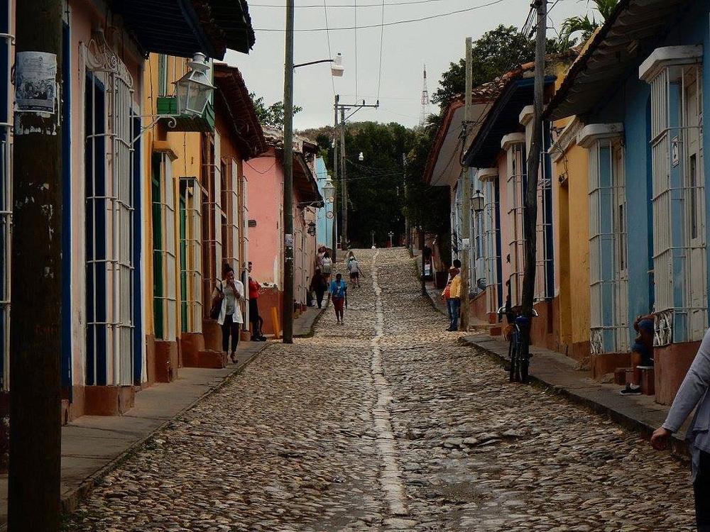 street with multi-colored houses in Trinidad, Cuba
