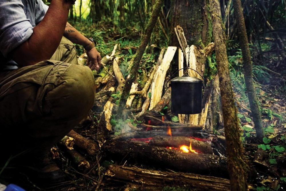 Indonesian jungle guide making tea
