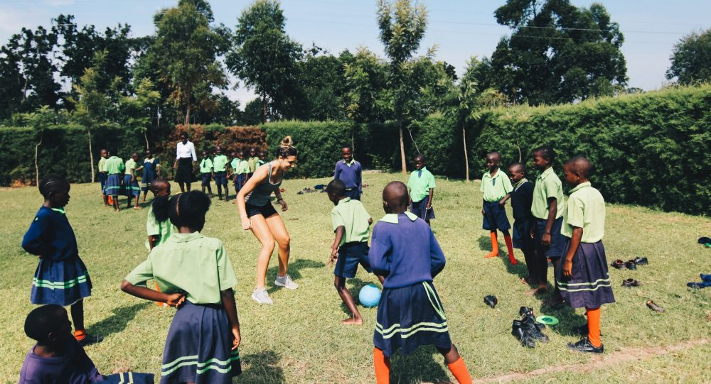 Taylor Ross '18 playing soccer with students in Kenya.