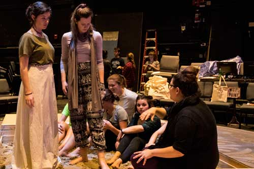 Student actors rehearsing for Trojan Women