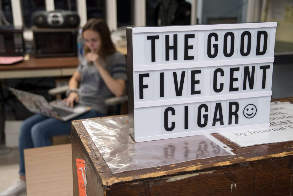 "A sign in the newspaper office that reads, ""The Good Five Cent Cigar"""