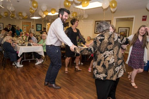 pharmacy students and seniors dancing at the resident's Senior Prom