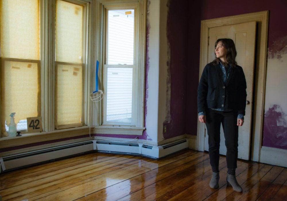 Vikki Warner in empty room of her house