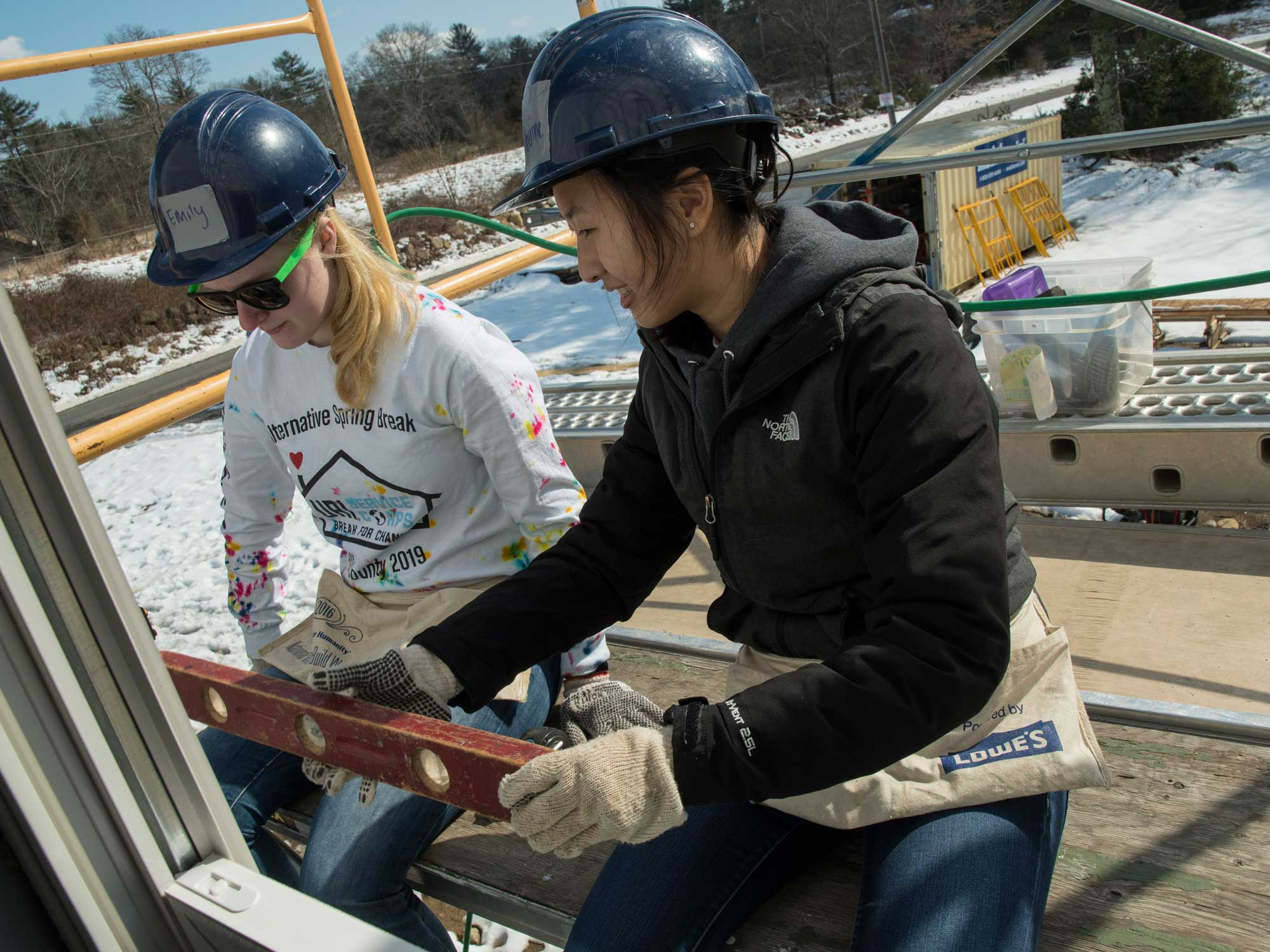 Students working on home construction for Habitat for Humanity