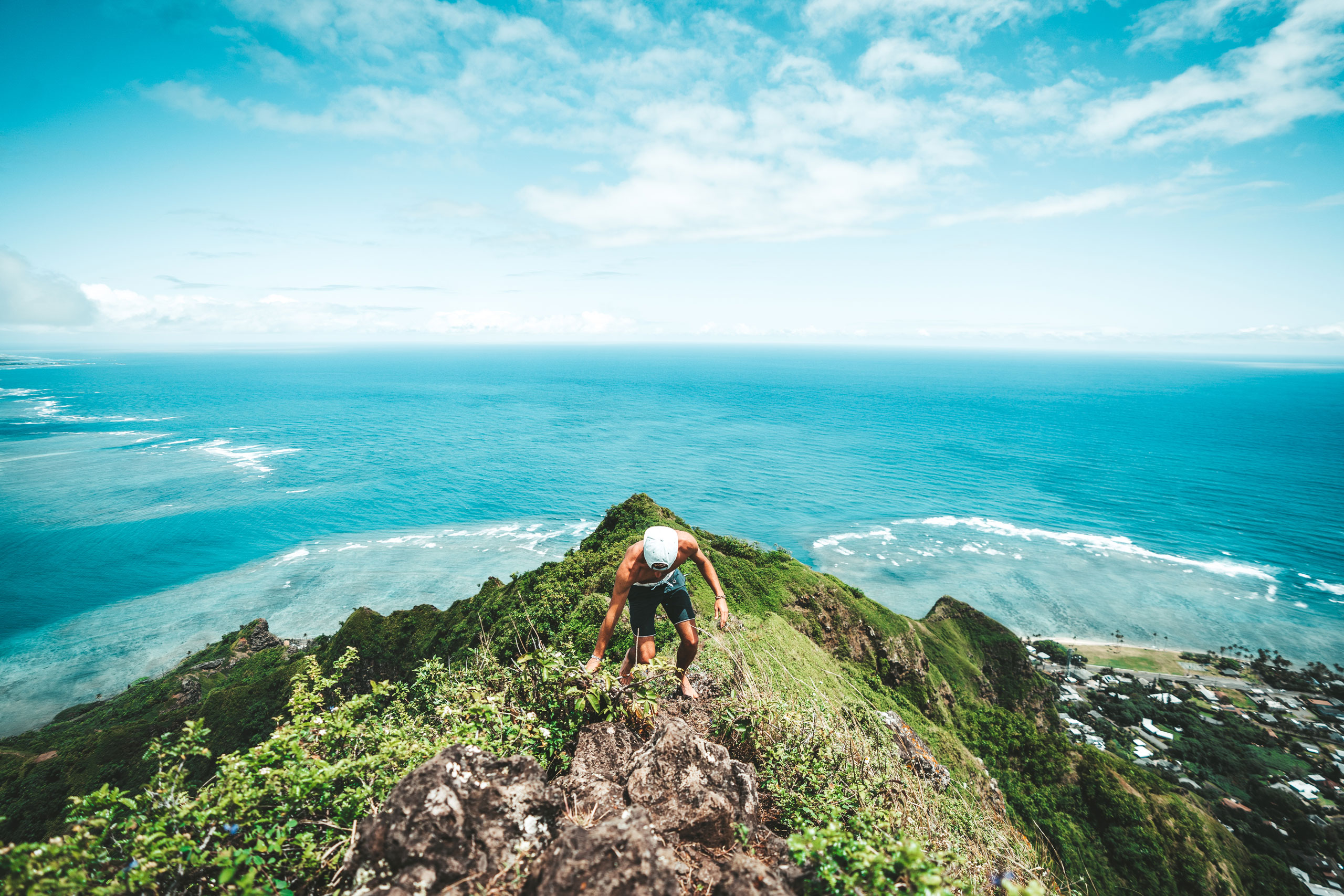Corey Favino climbing a mountain trail in Oahu, Hawaii