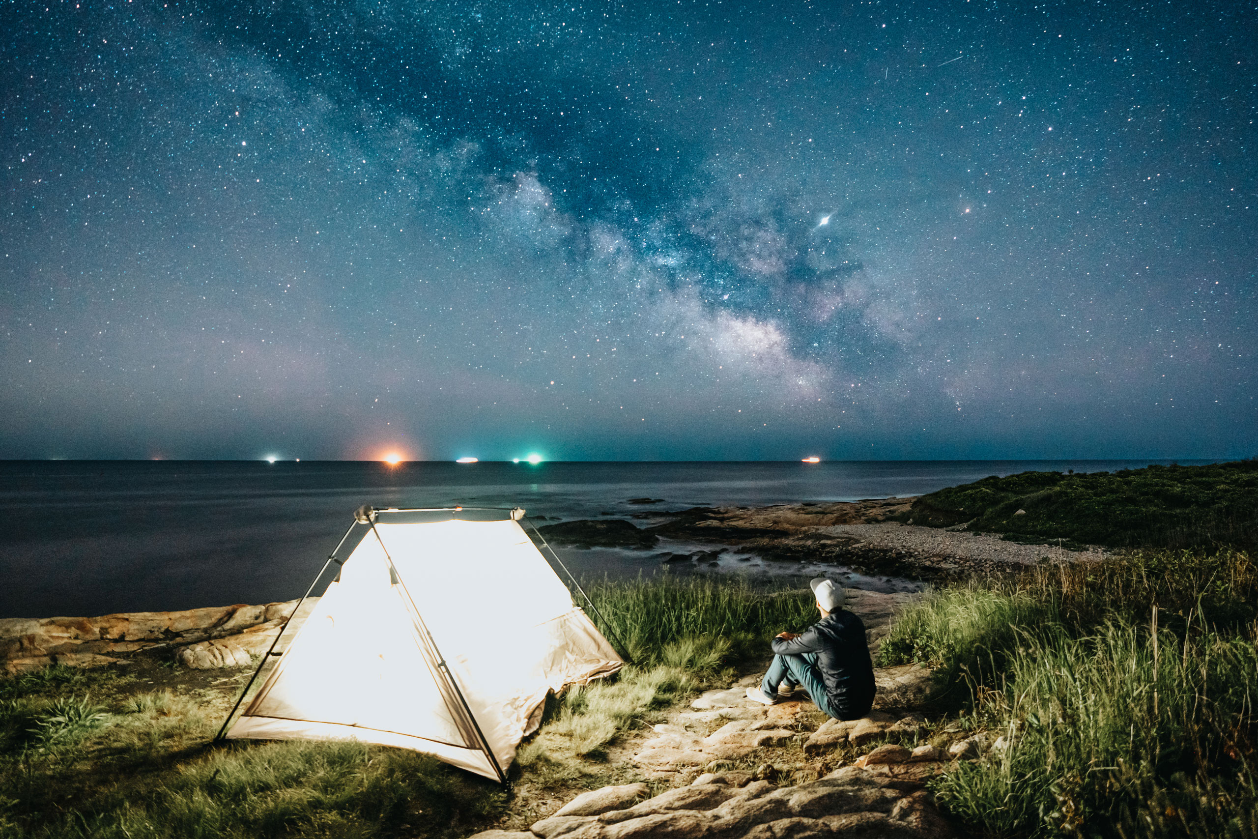 Corey Favino looking at the night sky over Narragansett