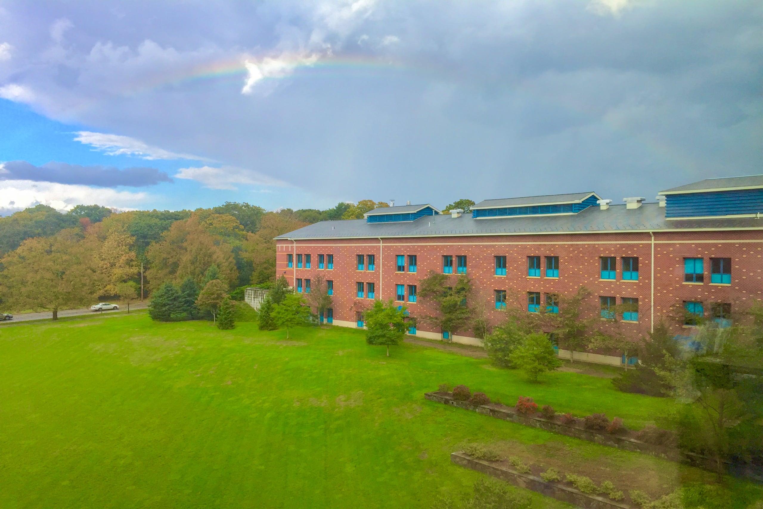 a rainbow over the Pharmacy quad
