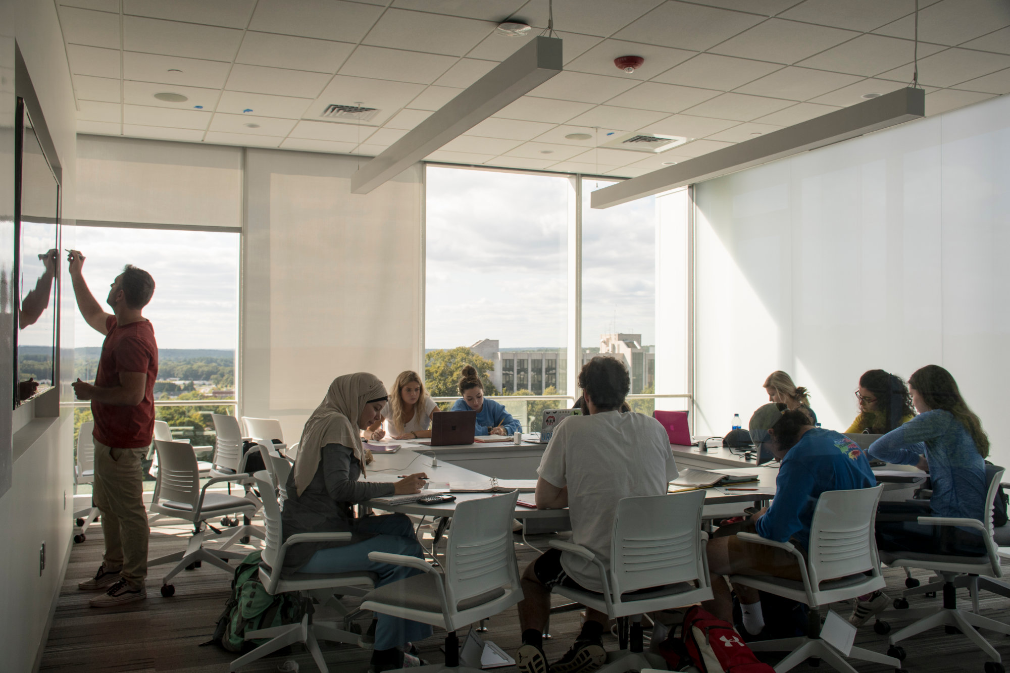 Students and their professor gathered for class in the new engineering facility