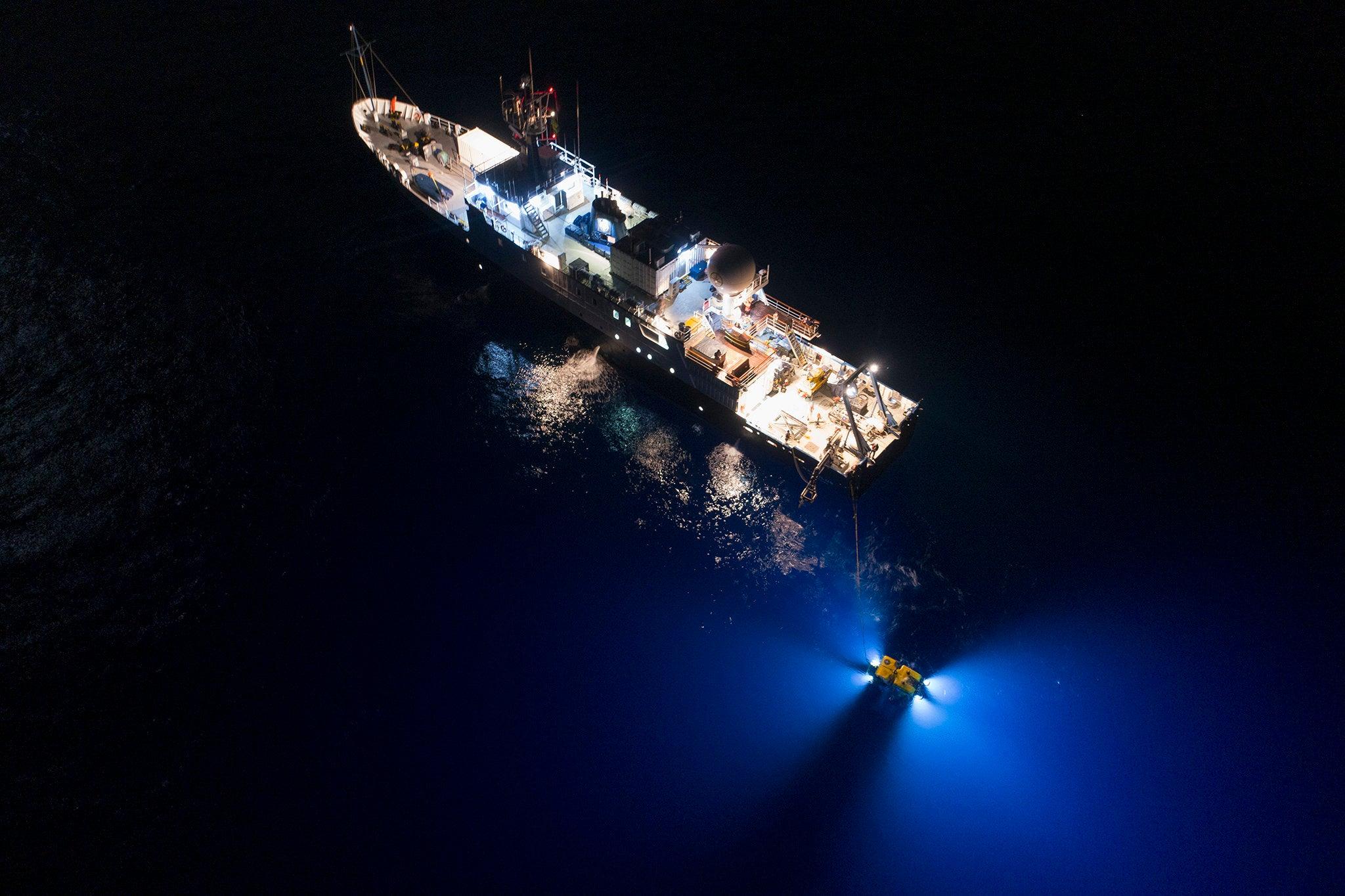 The E/V Nautilus at sea at night