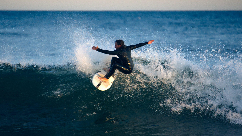 Brian Caccioppoli surfing