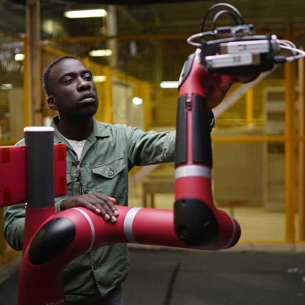 Engineering student Nathan Ankomah-Mensah in robotics lab