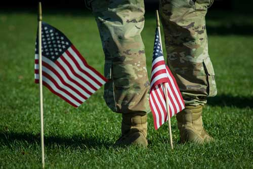 Soldiers and American flags on the Quad