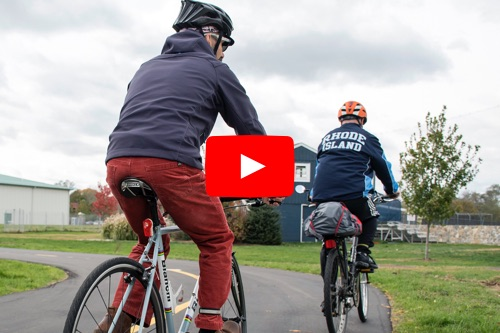 Two URI community members try out the new URI bike path spur.