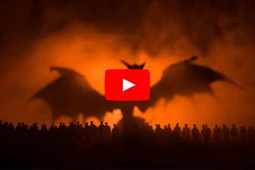 a dragon rears up over a crowd