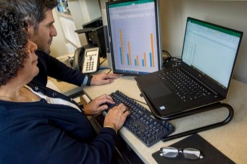 executives work at a computer