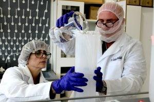 Rita Marcoux and Saleh Allababidi mix a batch of hand sanitizer