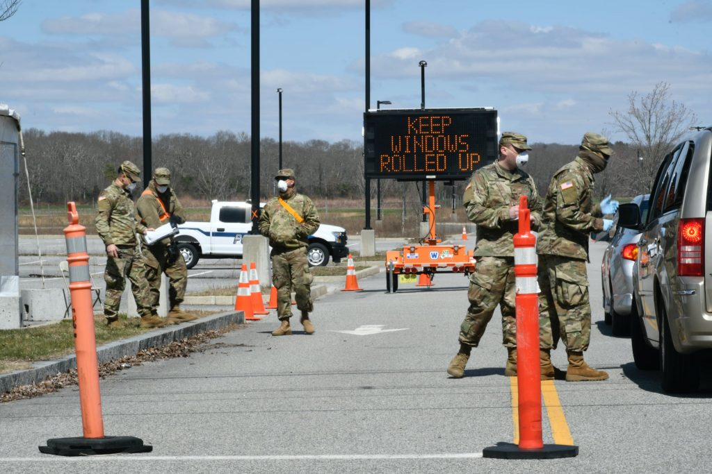 The National Guard staffs a drive-through COVID-19 testing center.