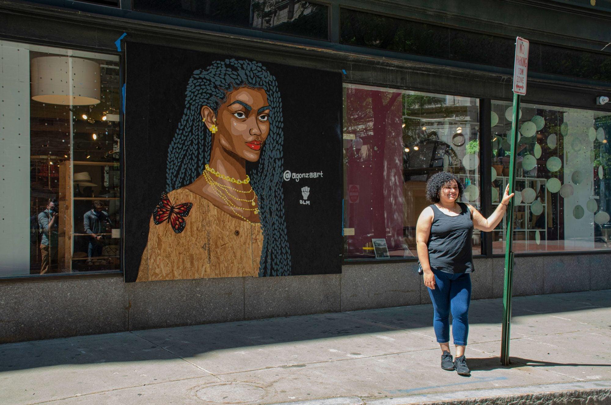 Artist Angela Gonzalez with her portrait of Jonét Nichelle.