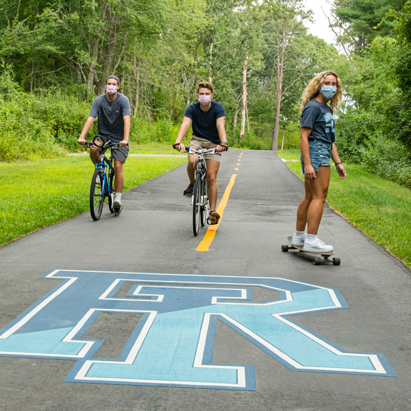 students wearing masks on the bike path