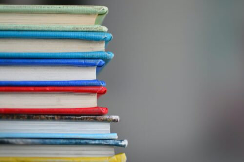 stack of brightly colored books