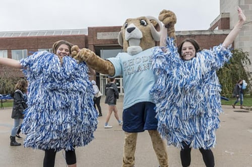 students cheering with the Rhody mascot