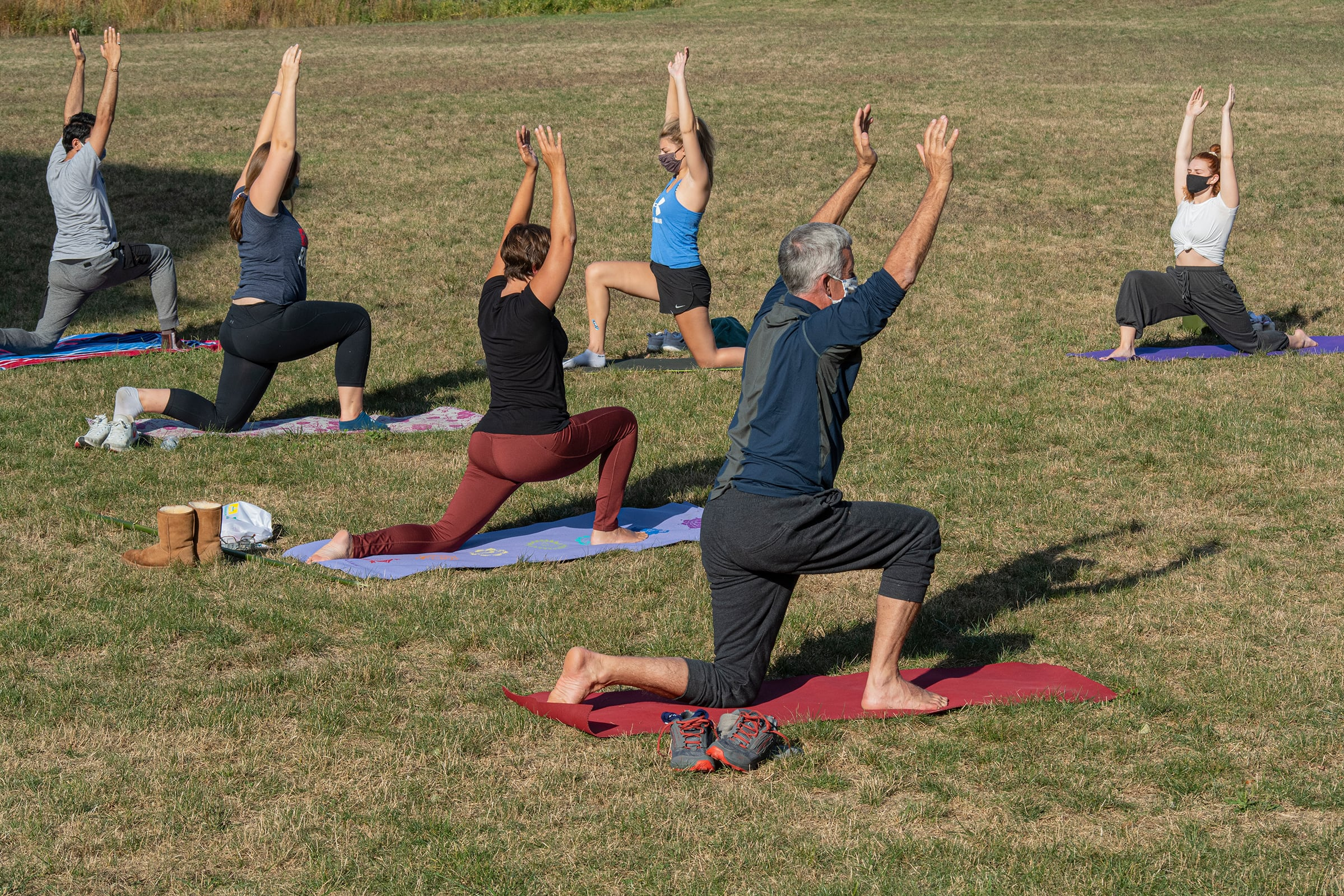 students, faculty, and staff doing yoga on the quad