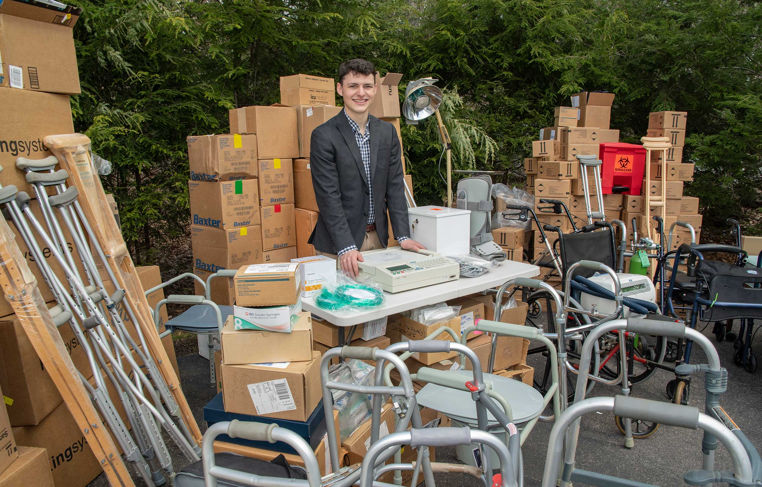 Thomas Bonneau surrounded by some of the medical supplies he has collected to be donated to those in need