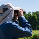 Coastal fellows student looking through binoculars