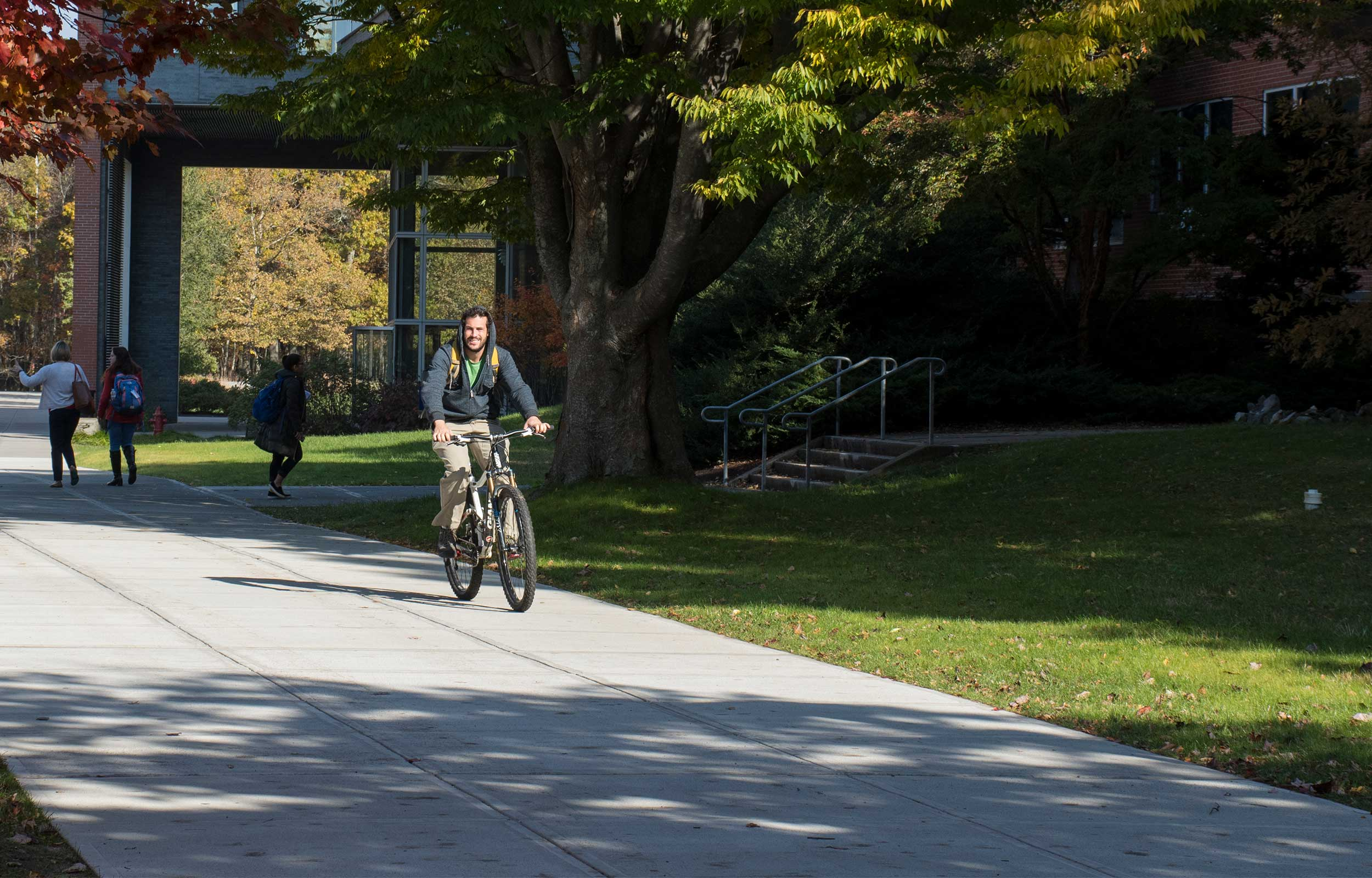 Boy riding a bike on campus